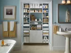 remodeled bathroom with storage cabinets tile backsplash