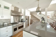 stainless appliances and pendant lighting in the kitchen