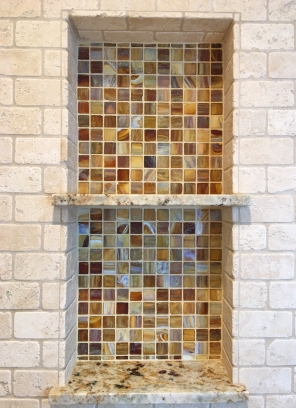 Updated shower stall with travertine and glass mosaic shampoo box in Mission Viejo Home